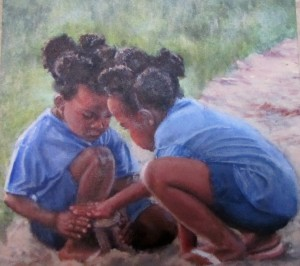 little girls playing in the sand